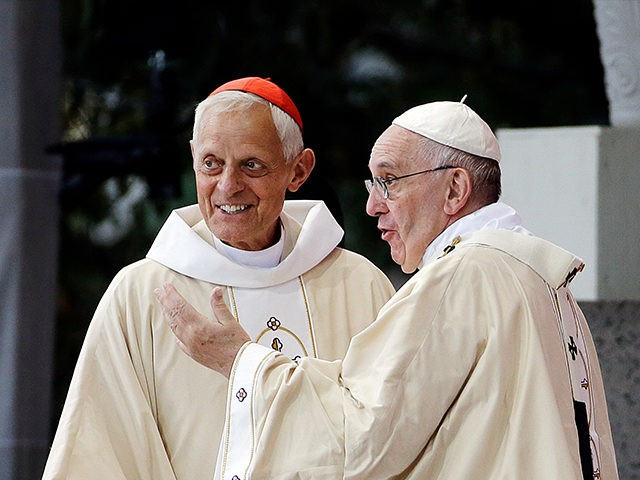 Cardinal Donald Wuerl, archbishop of Washington. left, looks toward the crowd with Pope Francis following a Mass outside the Basilica of the National Shrine of the Immaculate Conception Wednesday, Sept. 23, 2015, in Washington. (AP Photo/David Goldman)