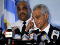 Chicago Police Superintendent Eddie Johnson listens as Chicago Mayor Rahm Emanuel speaks about Chicago's weekend of gun violence during a news conference at the Chicago Police Department 6th District station August 6, 2018 in Chicago, Illinois. Chicago experienced one of it's most violent weekends of the year, after more then …