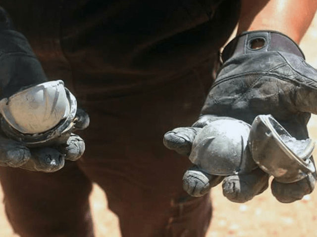 In this photo provided by the Syrian Civil Defense group known as the White Helmets, shows a member of Civil Defense displays the cluster bombs in the Khan Sheikhoun neighborhood of Idlib, Syria, Thursday, Sept. 29, 2016. The U.S. and Russia escalated their war of words over Syria Thursday as …