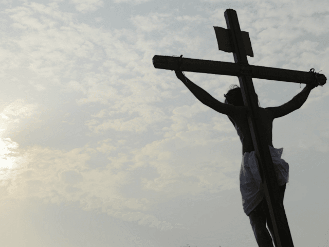Indian Catholic devotees re-enact the crucifixion of Jesus Christ during a Passion play at The Saint Joseph's church in Hyderabad on March 30, 2018. Passion plays are a dramatic presentation depicting the suffering and death of Jesus Christ and are an integral part of Good Friday celebrations for Catholics. / …