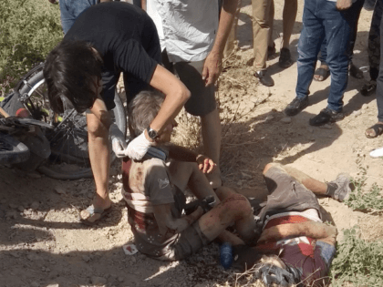 a woman helps a wounded cyclist, where the four tourists were killed when a car rammed into a group of foreigners on bicycles south of the capital of Dushanbe, Tajikistan. The Islamic State group on Tuesday claimed responsibility for a car-and-knife attack on Western tourists cycling in Tajikistan that killed …