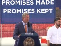 Bill de Blasio Appears with Trump Slogan Sign: 'Promises Made, Promises Kept'