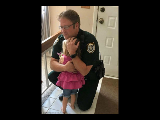 Video has been released of the dramatic moment in which an Seminole County, Florida, deputy, Bill Dunn, rescued an unconscious child from a hot car.
