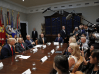 President Donald Trump, left, answers questions from the media during a discussion for drug-free communities support programs, in the Roosevelt Room of the White House, Wednesday, Aug. 29, 2018, in Washington. (AP Photo/Alex Brandon)
