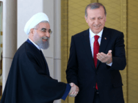 Turkish President Recep Tayyip Erdogan (R) shakes hands with his Iranian counterpart Hassan Rouhani during an official welcoming ceremony at the presidential complex in Ankara on April 16, 2016. / AFP / ADEM ALTAN (Photo credit should read ADEM ALTAN/AFP/Getty Images)