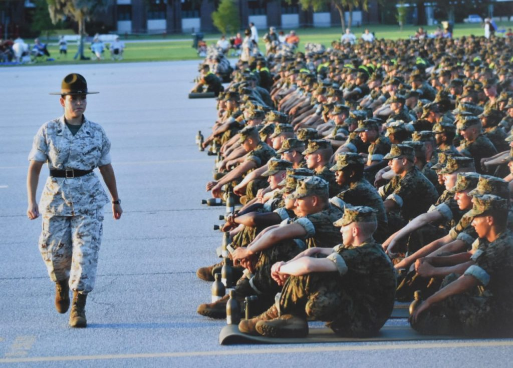 Woman Marine drill instructor inspects discipline of seated recruits lined up in platoon order for an Independence Day celebration at the Marine Corps Recruit Depot at Parris Island, South Carolina in 2004. [Penny Starr/Breitbart News]