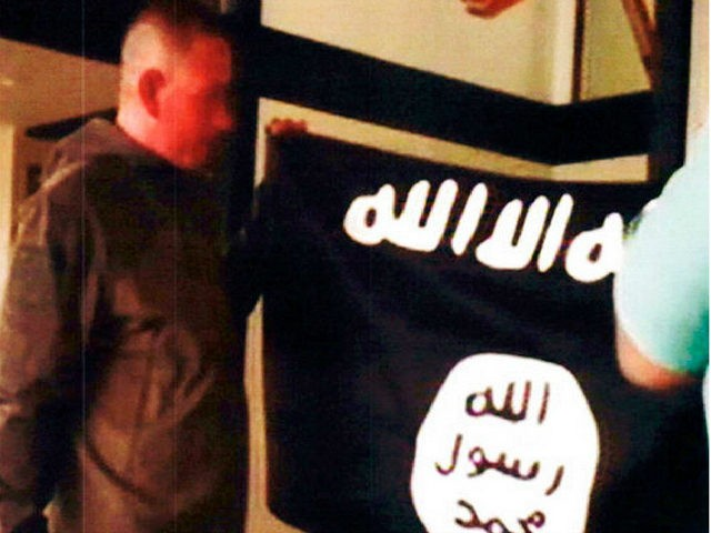 FILE - In this July 8, 2017 file image taken from FBI video and provided by the U.S. Attorney's Office in Hawaii on July 13, 2017, Army Sgt. 1st Class Ikaika Kang holds an Islamic State group flag after allegedly pledging allegiance to the terror group at a house in …