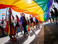 Participants carry a rainbow flag during the Gay Pride Parade on August 2, 2014, in Stockholm. AFP PHOTO/JONATHAN NACKSTRAND (Photo credit should read JONATHAN NACKSTRAND/AFP/Getty Images)