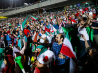 Iranian football supporters cheer for their national team during a screening of the Russia 2018 World Cup Group B football match between Iran and Spain in Azadi stadium in the capital Tehran on June 20, 2018. -
