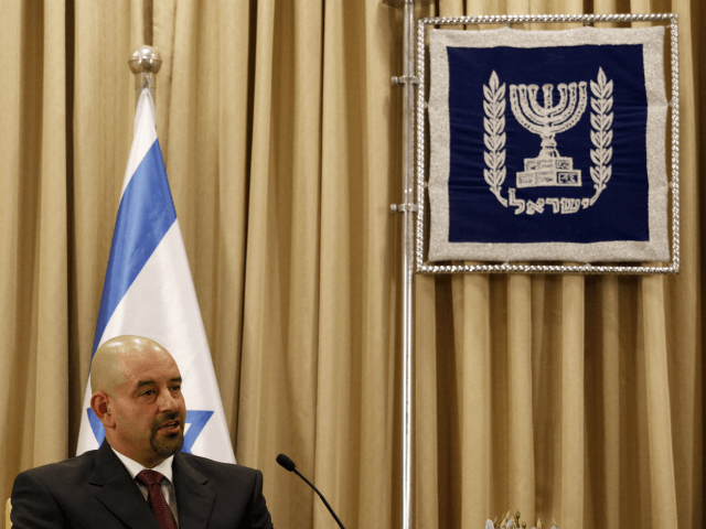 ordan's newly appointed ambassador to Israel Walid Obeidat speaks during his meeting with Israeli President Shimon Peres (unseen) upon presenting his credentials on October 17, 2012, at the presidential compound in Jerusalem. AFP PHOTO/GALI TIBBON (Photo credit should read GALI TIBBON/AFP/Getty Images)