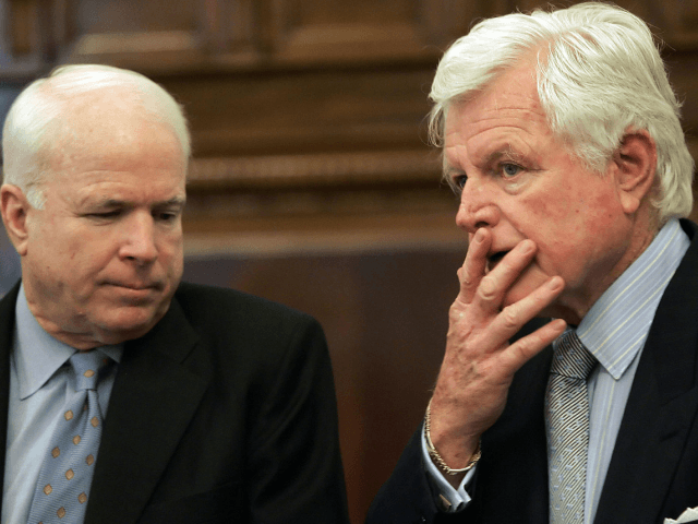 Washington, UNITED STATES: US Senator Ted Kennedy (R), D-MA, talks with US Senator John McCain, R-AZ, before an Emerging Threats and Capabilities Subcommittee hearing on detainee trails in light of Supreme Court ruling Hamdan vs. Rumsfeld on Capitol Hill in Washington, DC, 19 July 2006. AFP PHOTO/Jim WATSON (Photo credit …