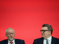 Labour Party leader Jeremy Corbyn (L) sits with Deputy leader Tom Watson on the first day of the Labour Party Conference the Exhibition Centre Liverpool on September 25, 2016 in Liverpool, England. Party leader Jeremy Corbyn will hope to re-unite the party after being re-elected leader yesterday. (Photo by Leon …