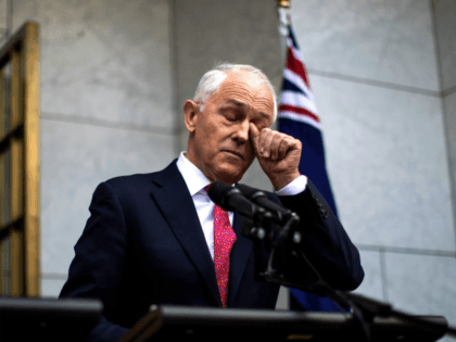 Australia's Prime Minister Malcolm Turnbull gestures as he takes part in a press conference in Canberra on August 21, 2018. - Embattled Australian Prime Minister Malcolm Turnbull narrowly survived a leadership challenge from within his own party on August 21 as discontent with his rule boiled over less than a …