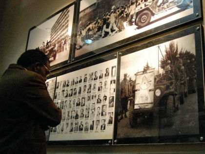 Visitors look at pictures on March 7, 2010 of victims of Ethiopia's 'Red Terror' campaign during the inauguration of the museum on March 7, 2010 in Addis Ababa. The museum took three years to complete and honours the dead with photographs of the 1977-78 campaign of state terror by former …