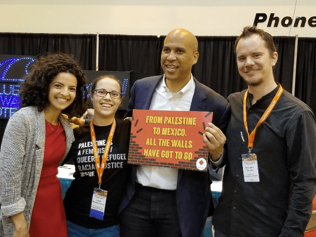 TEL AVIV – New Jersey senator Cory Booker, a possible contender for the 2020 Democratic presidential nomination, was photographed on Friday appearing to endorse a pro-Palestinian movement by holding a sign calling for the removal of the security fence in Israel.