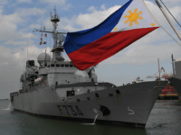 French navy frigate Vendemiaire prepares to dock while a Philippine flag flutters at the international port in Manila on March 12, 2018. FNS Vendemiaire, a Floreal class light surveillance frigate, commissioned in 1993, is here for a five-day goodwill visit. / AFP PHOTO / TED ALJIBE