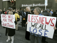 Newsroom employees hold signs outside the Pittsburgh Post Gazette building as they hold an informational picket in Pittsburgh, Monday, Dec. 11, 2006. The paper's owners said in September that they're prepared to sell the 220-year-old newspaper if its 14 unions don't agree to new contracts that would significantly cut costs …