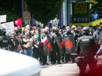 Alt-right activists, anti-fascist protestors, and people on all sides of the political spectrum gather for a campaign rally organized by right-wing organizer, Patriot Prayer founder and Republican Senate candidate Joey Gibson in Portland, Oregon, August 4, 2018. - Police in Portland braced for violence at the rally that has raised …