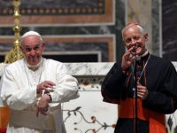 Cardinal Donald Wuerl, archbishop of Washington, right, translates for Pope Francis as the Pope wishes he had more time to greet everyone following the midday prayer from the Liturgy of Hours, the daily form of prayer of the Catholic Church, with bishops from the U.S., Wednesday, Sept. 23, 2015, at …