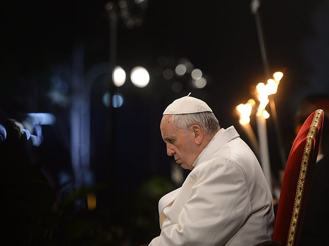 Pope Francis prays during the Way of the Cross torchlight procession at the Colosseum on Good Friday on April 3, 2015 in Rome. Christians around the world are marking the Holy Week, commemorating the crucifixion of Jesus Christ, leading up to his resurrection on Easter. AFP PHOTO / FILIPPO MONTEFORTE …