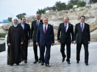 Russian President Vladimir Putin, second from right, Kazakhstan President Nursultan Nazarbayev, center, Turkmenistan President Gurbanguly Berdimuhamedow, right, President of Azerbaijan Ilham Aliyev, third from left, and Iranian President Hassan Rouhani, left, walk during the 5th Caspian summit at the Friendship Palace in Aktau, the Caspian Sea port in Kazakhstan, Sunday, …