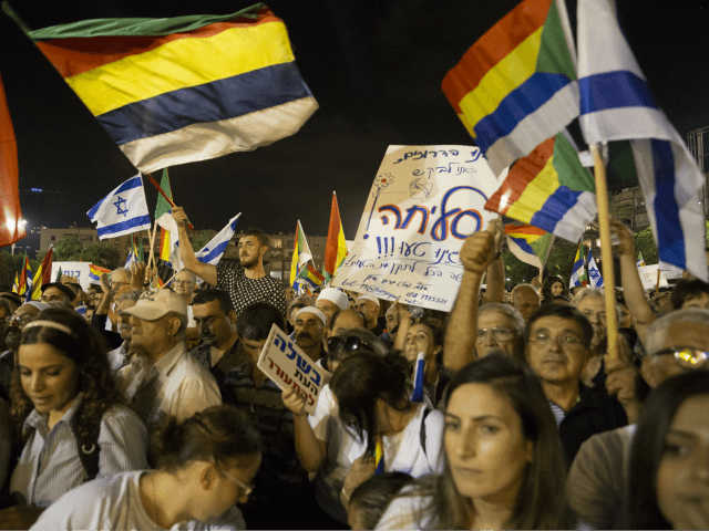 Thousands demonstrators take part in a protest against the 'Jewish State Nation Law' in Rabin Square on August 4, 2018 in Tel Aviv, Israel. The rally organized by Druze community members is in protest of the law that declares Israel the exclusive homeland of Jewish people. (Photo by Amir Levy/Getty …