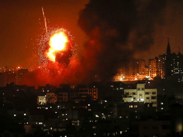 A picture taken on August 8, 2018 shows a fireball exploding during Israeli air strikes in Gaza City. (Photo by MAHMUD HAMS / AFP) (Photo credit should read MAHMUD HAMS/AFP/Getty Images)