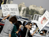 In this June 14, 2014 file photo, Egyptian women hold banners during a protest against sexual harassment in Cairo, Egypt. Accusations of sexual misconduct directed at two prominent human rights lawyers in Egypt -- one of them a former presidential hopeful -- have roiled the country's beleaguered civil society, which …