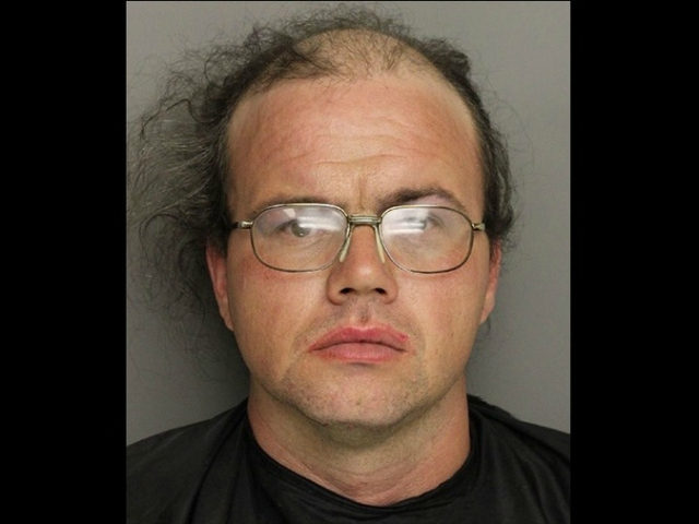 Shawn Thomas Hallett, wearing a dress and a wig, was arrested after a woman accused him of filming her in the woman's bathroom of a Greenville, South Carolina, gas station.