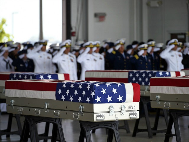 Flag draped transfer cases with the remains of American soldiers repatriated from North Korea are seen during a repatriation ceremony after arriving to Joint Base Pearl Harbor-Hickam, Honolulu, Hawaii, on August 1, 2018. - Sixty-five years after the Korean War ended, the remains of dozens of American soldiers killed during …