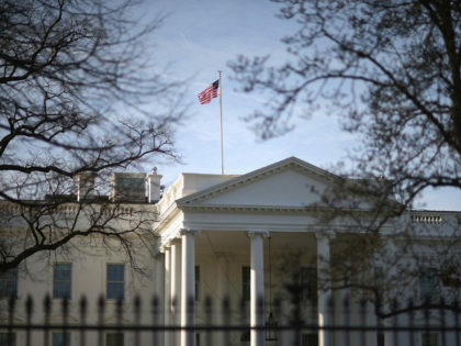 WASHINGTON, DC - MARCH 18: Morning sunlight strikes the flag flying above the White House March 18, 2015 in Washington, DC. The U.S. Secret Service said a letter sent to the White House tested positive for cyanide at an off-site mail screening facility Tuesday. (Photo by Chip Somodevilla/Getty Images)