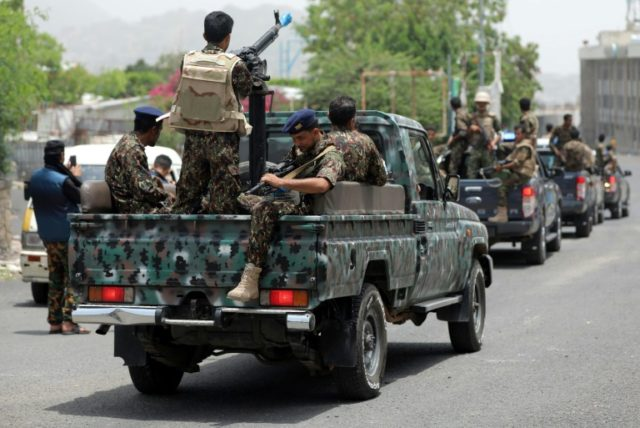 Yemeni police men, pictured July 2018, patrol the streets, as Yemen's ongoing conflict between the Saudi-backed government and rebels has killed nearly 10,000 people, the vast majority of them civilians