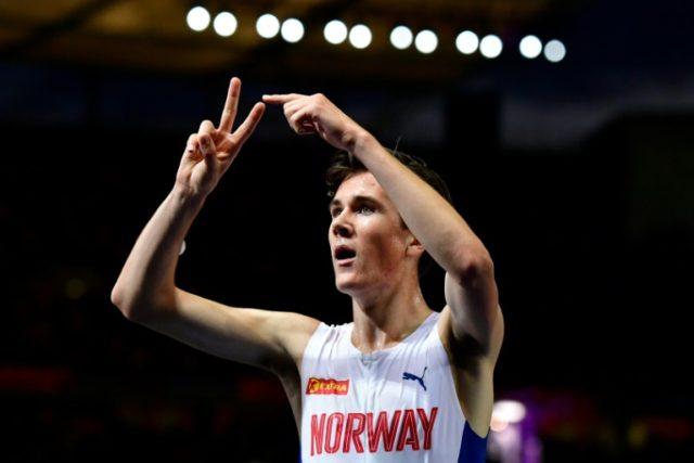 Double top: Norway's Jakob Ingebrigtsen celebrates winning the men's 5000m