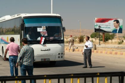 A bus transports Syrian refugees back from neighbouring Lebanon through the Jdeidat Yabus border crossing on August 13