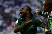 All over: Victor Moses celebrates scoring a penalty to equalise during the World Cup match between Nigeria and Argentina