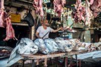 Zinhum Abdelmoneem works at his butchery in Cairo on August 16, 2018, ahead of the annual Muslim Eid al-Adha holiday