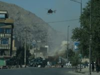 An Afghan army helicopter swooped in low over the street near the Eidgah Mosque in a central district of the city and fired a rocket on a militant position