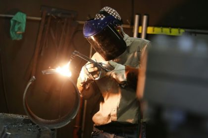 A worker welds pipe at an Ohio factory in 2016; Washington has said China was selling large diameter welded pipe used in the oil and gas industry far below the fair price, harming US industry