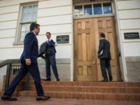 Mexico's Secretary of Economy Ildefonso Guajardo (L) enters the Office of the US Trade Representative during a day of meetings on the NAFTA treaty in Washington