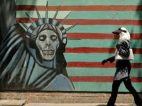 A mural on the wall of the former US embassy in the Iranian capital Tehran. US President Donald Trump has imposed biting sanctions on Iran, triggering a mix of anger, fear and defiance