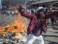 The Latest: Zimbabwe's president blames opposition for chaos