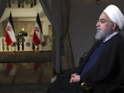 In this photo released by official website of the office of the Iranian Presidency, President Hassan Rouhani addresses the nation in a televised speech in Tehran, Iran, Monday, Aug. 6, 2018. Iranian President Hassan Rouhani struck a hard line Monday as the U.S. restored some sanctions that had been lifted …