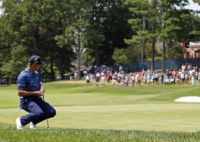 The Latest: Woodland makes mess in sand at PGA Championship