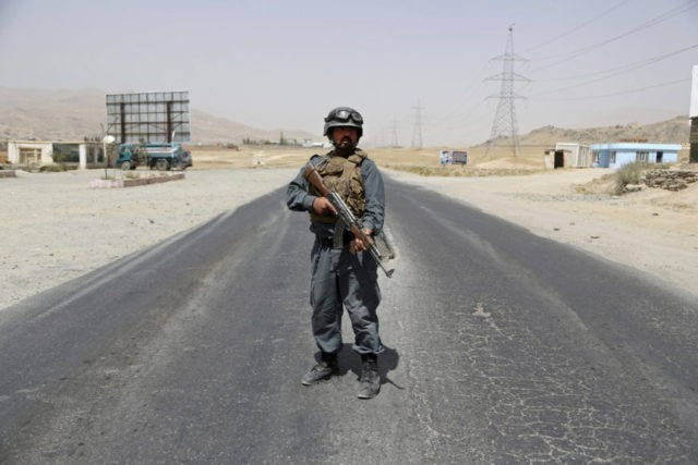 An Afghan Police officer mans a checkpoint on the Ghazni highway, in Maidan Shar, west of Kabul, Afghanistan, Monday, Aug. 13, 2018. Afghan Defense Minister Gen. Tareq Shah Bahrami said Monday that about 100 policemen and soldiers as well as 20 civilians have been killed in past four days of …