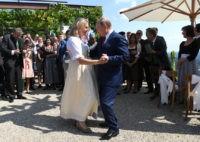 Putin dances at Austrian wedding; talks with Merkel on Syria