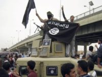 In this March 30, 2014, file photo, Islamic State group militants hold up their flag as they patrol in a commandeered Iraqi military vehicle in Fallujah, Iraq. The United States on Aug. 24, 2018, sanctioned three members of the Islamic State who were featured in a beheading video distributed by …