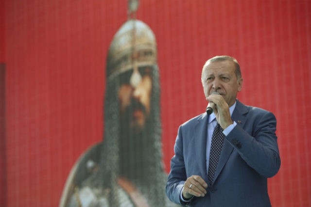 Turkey's President Recep Tayyip Erdogan delivers a speech during a ceremony to mark the anniversary of the Battle of Manzikert in eastern Mus province, eastern Turkey, Sunday, Aug. 26, 2018. Turkish Seljuks beat the Byzantine forces at the Battle of Manzikert (now Malazgirt, Turkey) in 1071, gaining entry into Anatolia …