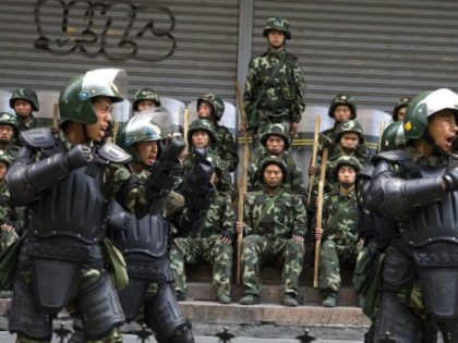 In this July 10, 2009, file photo, Chinese paramilitary police practice during a break from patrol in Urumqi, western China's Xinjiang province. A group of U.S. lawmakers has urged the Trump administration to impose sanctions including asset freezes and visa bans on Chinese officials and companies allegedly tied to a …