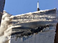 Smoke pours from a gaping hole and the upper floors of the World Trade Center's North Tower, shortly after hijackers crashed American Airlines Flight 11 into the building on September 11, 2001 in New York City. #