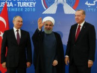 Iran's President Hassan Rouhani, centre, flanked by Russia's President Vladimir Putin, left, and Turkey's President Recep Tayyip Erdogan, pose for photographs in Tehran, Iran, ahead of their summit to discuss Syria, Friday, Sept. 7, 2018. The three leaders began a meeting to discuss the war in Syria. (Presidential Press Service …